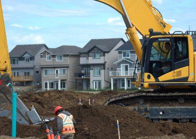 Komat'su Excavator Digging Lines at Edgemont